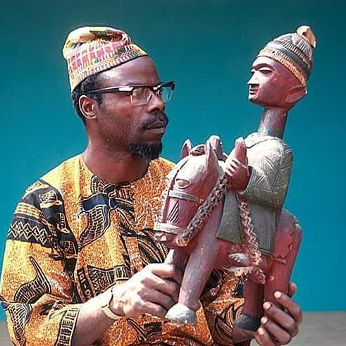 Traditional Sculptor, Lamidi Olonade Fakeye, at work, Ibadan, Nigeria. Circa: 1970.